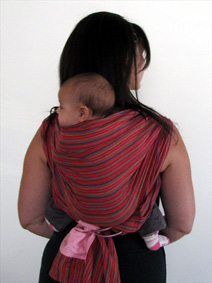 Back carry with ring sling for young babies