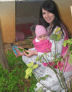 gardening with baby in asteraki sling