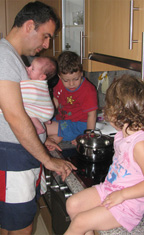cooking_while_babywearing_newborn